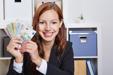 Happy business woman with Euro money