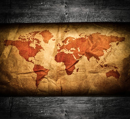 Antique world map in grunge wooden frame