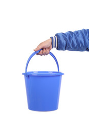Hand holding blue bucket.