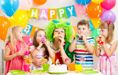 children and clown at birthday party