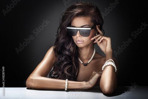 Fototapeta Portrait of modern young attractive brunette beauty.