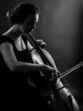 Female playing the cello black and white