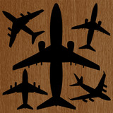 silhouettes of airplanes on the wooden background