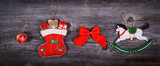 Christmas decorative ornaments on wooden background