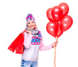 Smiling woman with gifts and red balloons after shopping