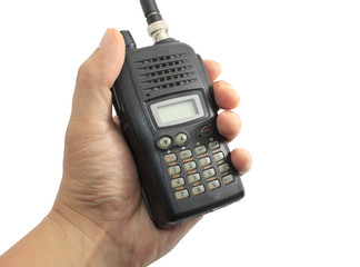 Hand holding black ham radio isolated on white