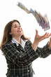 Woman throwning money in the air
