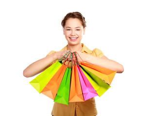 Young girl holding shopping bag, isolated on white background