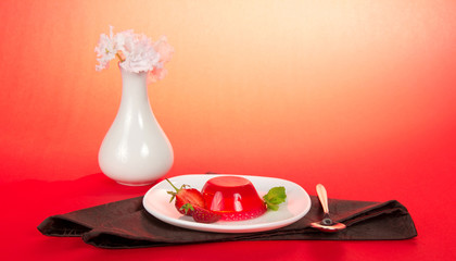 Plate jelly, spoon, vase with the flowers