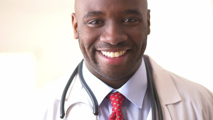 Close up of African American doctor smiling