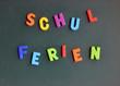 Schulferien Buchstaben auf Kreidetafel