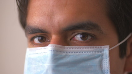 Hispanic doctor in surgical mask