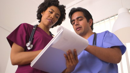 Low angle view of medical professionals reviewing medical charts