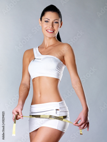 Smiling healthy woman after dieting measures hip