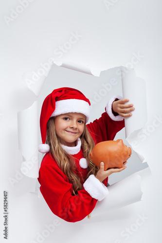 Little santa girl saving for christmas presents