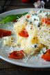 pasta with grated cheese and tomatoes