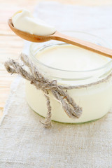 sour cream in a small glass jar