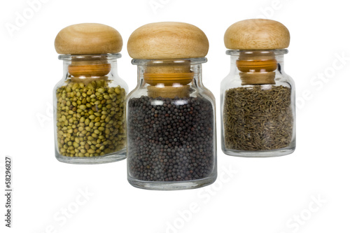 Three containers of assorted spices