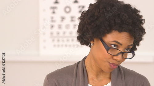 African American woman wearing glasses at optometrist