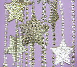 Silver Stars garland on purple background