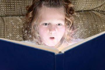 little girl enjoying magic of reading