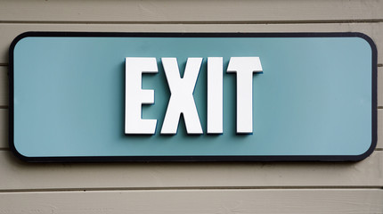 Exit sign on wooden panel