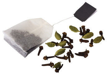 Close-up of a teabag with cloves and cardamoms