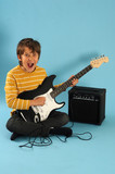 Boy plaing electric guitar