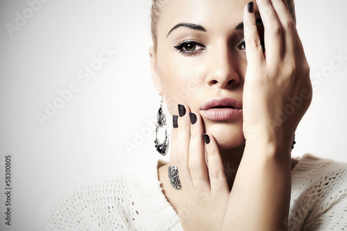 Beautiful woman in woolen dress.Jewelry and Beauty.manicure