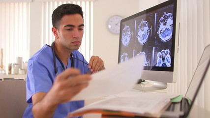 Mexican doctor analyzing brain x-rays