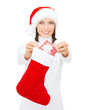 smiling woman with small giftbox and stocking