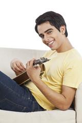 Portrait of a happy man playing a mandolin