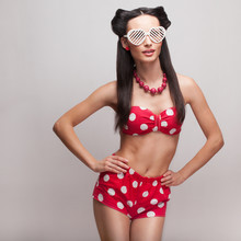 Pin Up model in heart shaped sunglasse