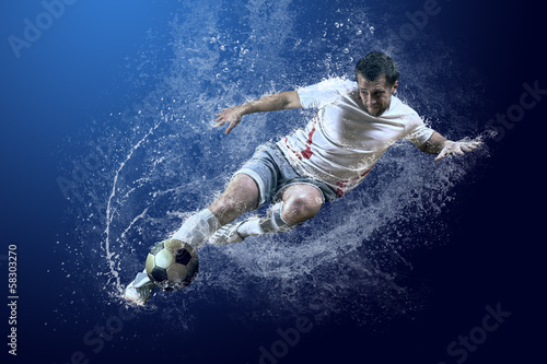 Splash of drops around football player under water - 58303270