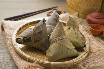rice dumplings and chinese tea on bamboo place mat