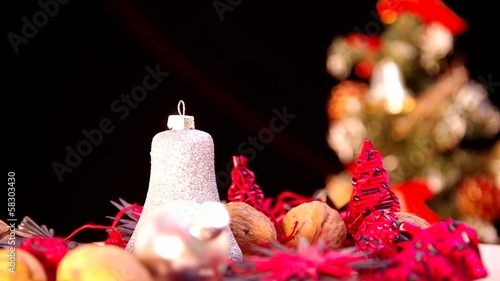 Christmas bell revolve in the background with Christmas tree