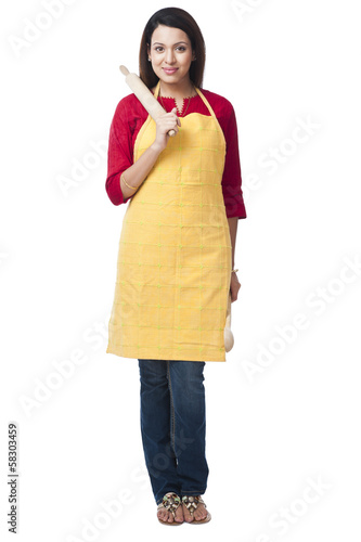 Portrait of a woman holding a rolling pin