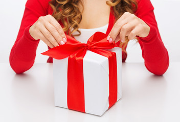 woman hands opening gift boxes