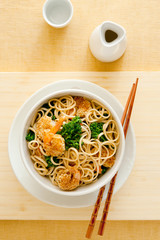 Asian noodles with broccoli and sesame shrimp.