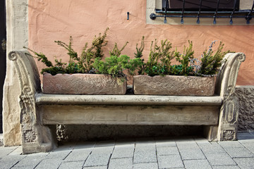 Stone carving bench in old town