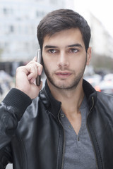 Young Man talking with cell phone