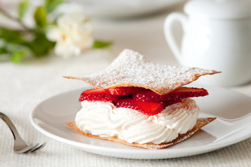 Closeup of strawberries and cream on sugared wonton wrappers.