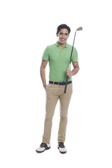Male golfer holding a golf club and smiling