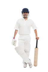 Portrait of a batsman standing with a cricket bat