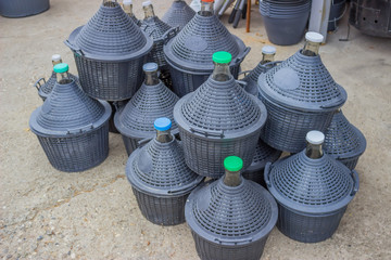 pile of gallons for water and wine