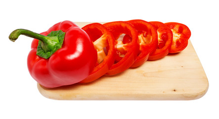 Sliced red pepper on cutting board isolated on white