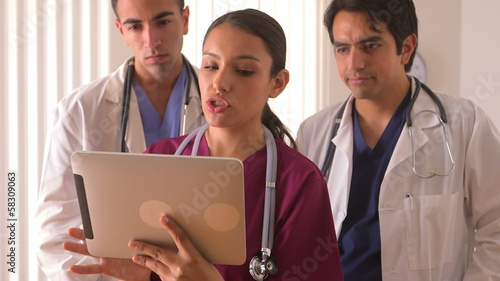 Team of Mexican doctors working on a tablet
