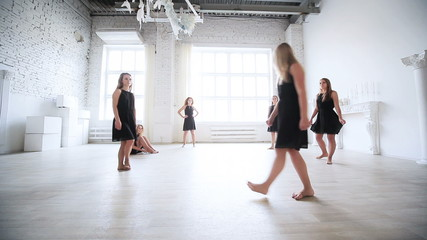 Instructor teaching dancing team.