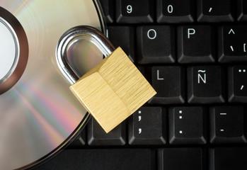 Closed padlock, keyboard and DVD - data security
