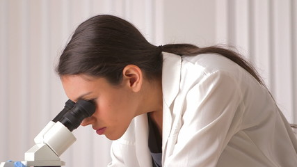 Mexican scientist working with microscope